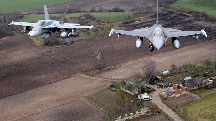 Portuguese Air Force fighter F-16 (R) and Canadian Air Force fighter CF-18 Hornet patrol over Baltics air space, from the Zokniai air base near Siauliai November 20, 2014.(Reuters / Ints Kalnins)