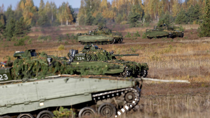 CV-90 combat vehicles from the Norwegian army attend the Silver Arrow NATO military exercise in Adazi, Latvia.(Reuters / Ints Kalnins)