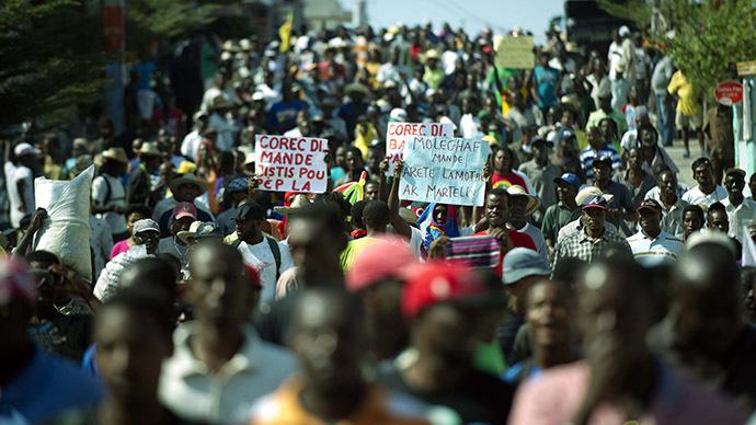 Haiti PM steps down amid anti-govt protests (PHOTOS, VIDEO)