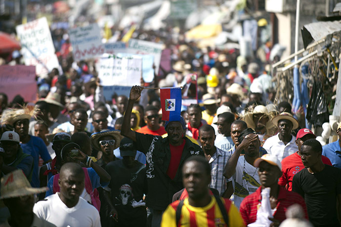 Demonstrators march during a protest against the government of President Michel Martelly in Port-au-Prince, on December 13, 2014. (AFP Photo/Hector Retamal)