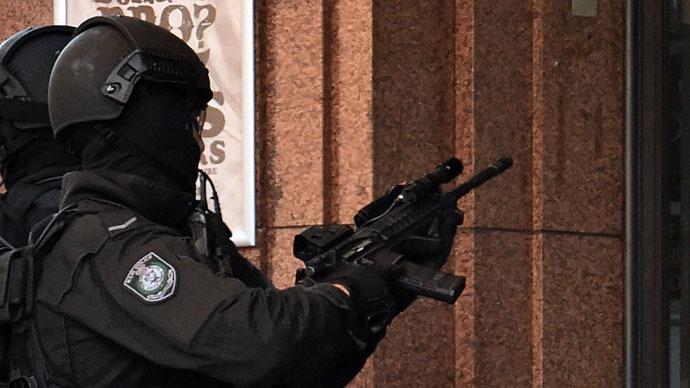 Sydney gunman identified as Iranian-born Man Haron Monis, on bail for violent crimes