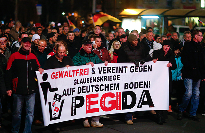"Participants hold a banner during a demonstration called by anti-immigration group PEGIDA, a German abbreviation for ""Patriotic Europeans against the Islamization of the West"", in Dresden December 15, 2014. (Reuters / Hannibal Hanschke)"