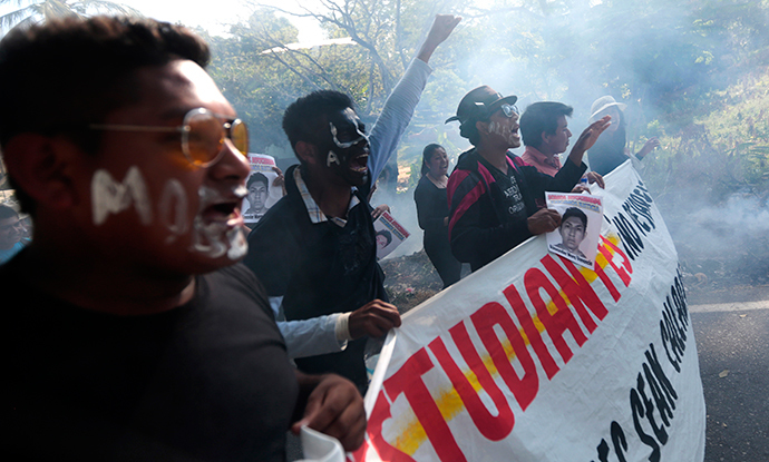 People shout slogans during a protest march at Tecoanapa, in Guerrero State, Mexico (AFP Photo / Pedro Pardo)