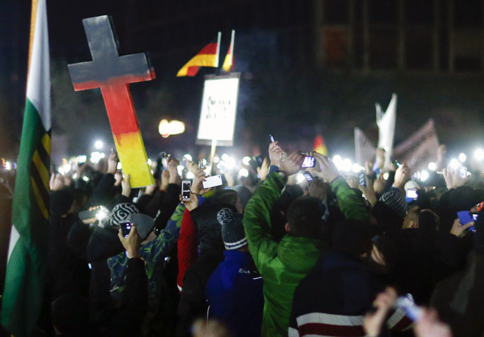 "Participants hold up their mobile phones during a demonstration called by anti-immigration group PEGIDA, a German abbreviation for ""Patriotic Europeans against the Islamization of the West"", in Dresden December 8, 2014. (Reuters)"
