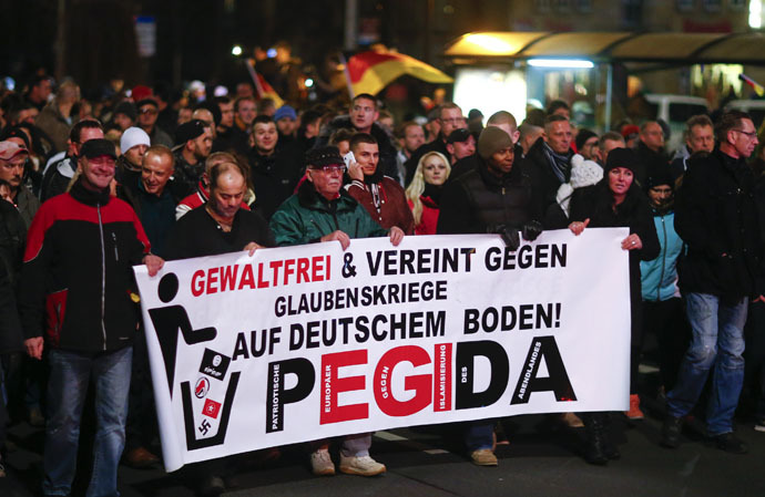 "Participants hold a banner during a demonstration called by anti-immigration group PEGIDA, a German abbreviation for ""Patriotic Europeans against the Islamization of the West"", in Dresden December 15, 2014. (Reuters)"
