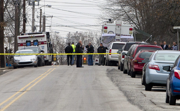 Police has the streets taped off as the search near a home in a suburb of Philadelphia where a suspect in five killings was believed to be barricaded in Souderton, Pennsylvania, December 15, 2014 (Reuters)