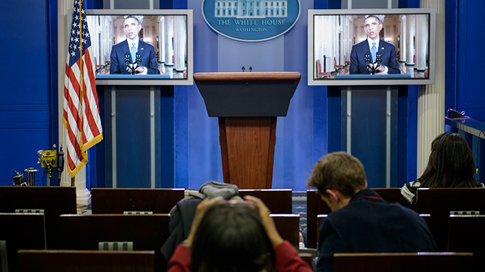 US President Barack Obama is seen on screens in the White House briefing room during a televised address to the nation November 20, 2014 in Washington, DC on immigration reform. (AFP Photo / Brendan Smialowski)