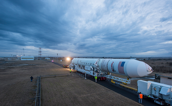 This NASA handout photo shows An Orbital Sciences Corporation Antares rocket seen as it is rolled out to launch Pad-0A at NASA's Wallops Flight Facility on January 5, 2014 in advance of a planned January 8 launch, Wallops Island, Virginia. (AFP Photo / NASA / Bill Ingalls / Handout)