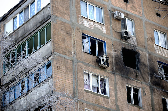 A destroyed apartment block window after a shell hit the building in the Petrovskiy district, of the eastern Ukrainian city of Donetsk which is controlled by Donetsk People's Republic (DNR), on December 2, 2014. (AFP Photo/Eric Feferberg)