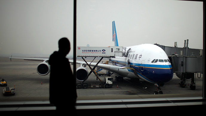 Early exit? Chinese first-time flyer opens plane emergency door