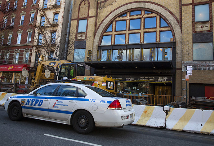 A New York City Police Department (NYPD) vehicle drives by the Sunshine Cinema in New York December 17, 2014. (Reuters/Andrew Kelly)