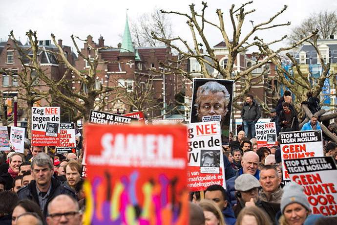 People take part in a protest against Geert Wilders, leader of the Dutch hard-right Freedom Party, in Amsterdam March 22, 2014. (Reuters/Cris Toala Olivares)
