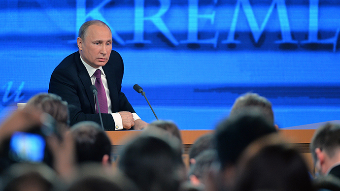 Russian President Vladimir Putin gestures as he speaks during his annual press conference in Moscow on December 18, 2014 (AFP Photo / Alexander Nemenov)
