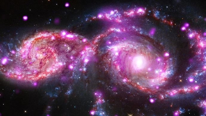 Galaxies spiral into each other, create spectacular light show (VIDEO, PHOTOS)