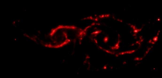 Infrared image of NGC 2207 and IC 2163 spiral galaxies (NASA/JPL-Caltech)
