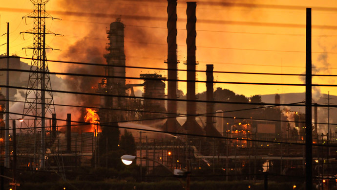 Firefighters douse a flame at the Chevron oil refinery in in Richmond, California August 6, 2012.(Reuters / Josh Edelson)