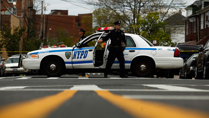 Plainclothes NYPD officer hits teen subdued by other cops (VIDEO)