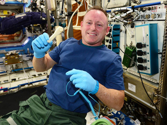 "ISS Commander Barry ""Butch"" Wilmore holds up the ratcheting socket wrench on the space station right after we 3D-printed it (Image Credit: NASA)"