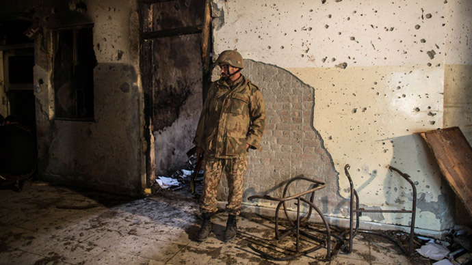 An army soldier inspects the Army Public School, which was attacked by Taliban gunmen, in Peshawar, December 17, 2014. (Reuters / Zohra Bensemra)