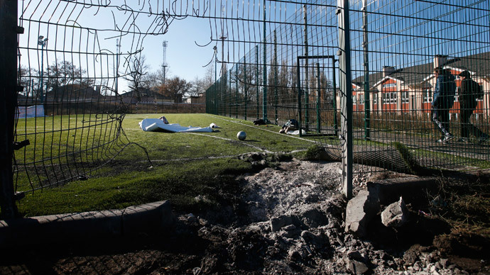 A crater caused by shelling is seen near a school's soccer field in Donetsk, eastern Ukraine, November 6, 2014.(Reuters / Maxim Zmeyev )