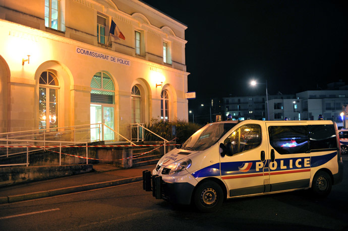 """A police car is parked outside the police station of Joue les-Tours on December 20, 2014 where French police shot dead a man who attacked them with a knife in a police station while shouting """"Allahu Akbar"""" (""""God is great"""" in Arabic). (AFP Photo)"""