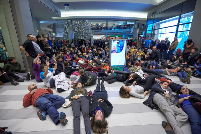 "Thousands of protesters from the group ""Black Lives Matter"" disrupt holiday shoppers on December 20, 2014 at Mall of America in Bloomington, Minnesota. (Adam Bettcher/Getty Images/AFP)"