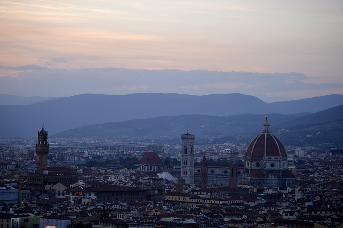A general view shows a panorama of the city of Florence with the Duomo (R) of the cathedral Santa Maria del Fiore and the tower of the Palazzo Vecchio (L), Florence's city hall (AFP Photo / Filippo Monteforte)