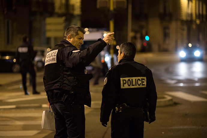 "Policemen gesture on December 21, 2014 in Dijon on the site where a driver shouting ""Allahu Akbar"" (""God is great"") ploughed into a crowd injuring 11 people, two seriously, a source close to the investigation said (AFP Photo / Arnaud Finistre)"