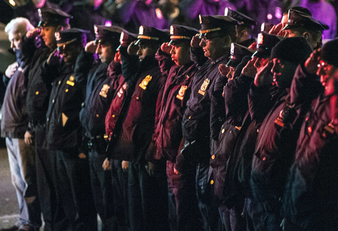 Police officers line the route as vehicles containing the bodies of the two New York Police officers who were shot dead drive by in the Brooklyn borough of New York, December 20, 2014. (Reuters/Stephanie Keith)