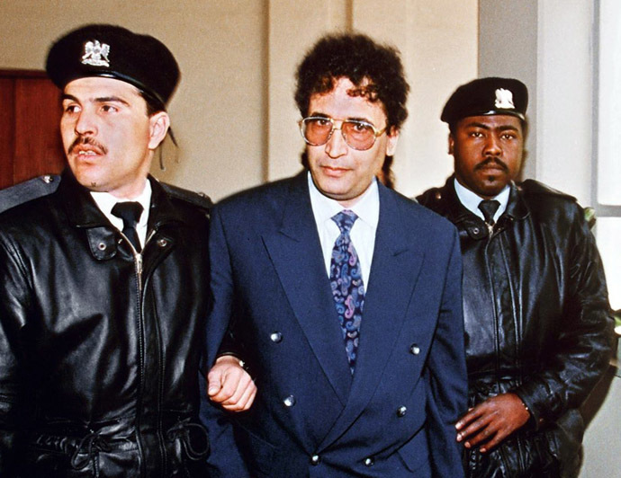 File photo taken February 18, 1992 in Tripoli shows convicted Lockerbie bomber Abdelbaset Ali Mohmet al-Megrahi (C) being escorted by security officers. (AFP Photo/Manoocher Deghati)