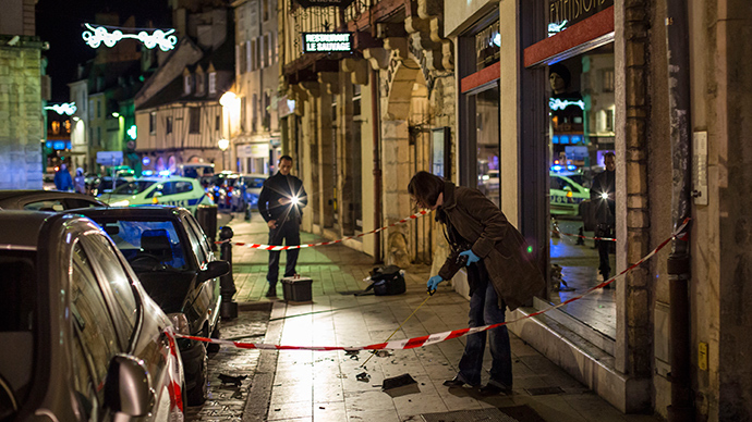 "A policewoman collects evidence on December 21, 2014 in Dijon on the site where a driver shouting ""Allahu Akbar"" (""God is great"") ploughed into a crowd injuring 11 people, two seriously, a source close to the investigation said (AFP Photo / Arnaud Finistre)"