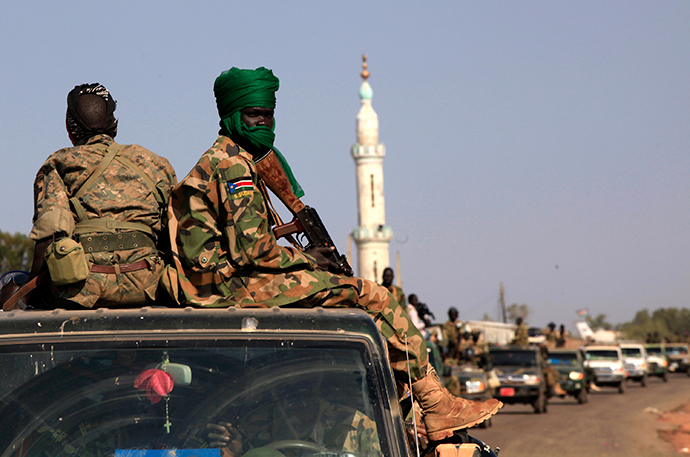 SPLA soldiers sit at the back of a pick-up truck in Bentiu, Unity state (Reuters / Andreea Campeanu)