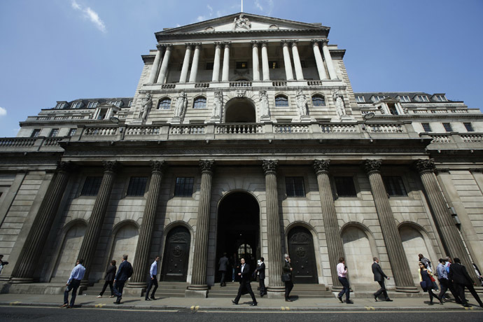 Pedestrians walk past the Bank of England in the City of London (Reuters/Luke MacGregor)