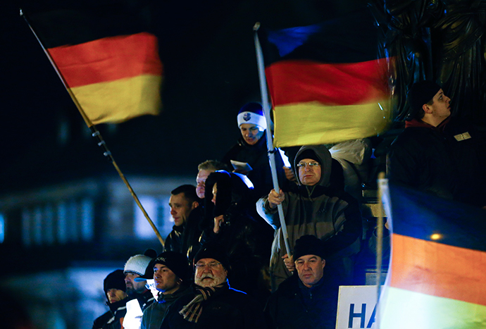 "Participants hold German national flags during a demonstration called by anti-immigration group PEGIDA, a German abbreviation for ""Patriotic Europeans against the Islamization of the West"", in Dresden December 22, 2014. (Reuters / Hannibal Hanschke)"