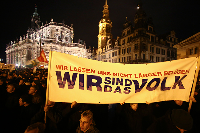 "Participants hold a banner during a demonstration called by anti-immigration group PEGIDA, a German abbreviation for ""Patriotic Europeans against the Islamization of the West"", in Dresden December 22, 2014. (Reuters / Hannibal Hanschke)"