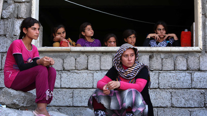 Iraqi Yazidi women who fled the violence in the northern Iraqi town of Sinjar. (AFP Photo/Safin Hamed)