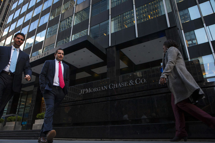 People walk by the JP Morgan & Chase Co. building in New York. (Reuters/Eric Thayer)