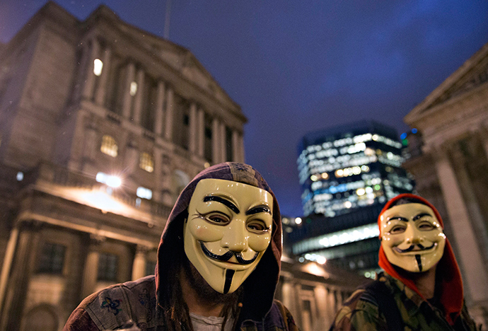 Supporters of the activist group Anonymous wear masks to protest against the BBC outside the Bank of England in London December 23, 2014 (Reuters / Neil Hall)