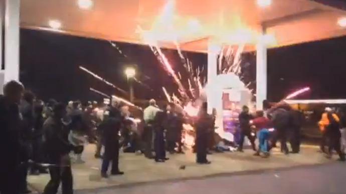 Police shoot & kill armed black teen in St. Louis area