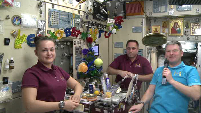 New Year's space dinner: Fruit and a tin of black caviar floating around the space station as ISS crew get ready to celebrate Christmas and New Year.