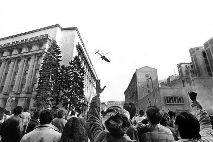 File photo of people gesturing towards a helicopter in which Ceausescu fled the Romanian Communist Party Central Committee headquarters in Bucharest December 22, 1989. (Reuters)
