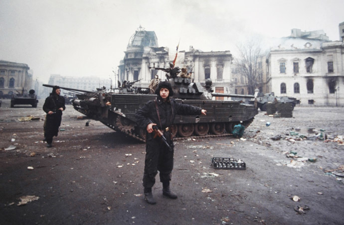 A soldier gestures after an exchange of fire between the army backed up by armed civilians and pro-Ceausescu supporters in Bucharest December 24, 1989. (Reuters/Eric Gaillard)
