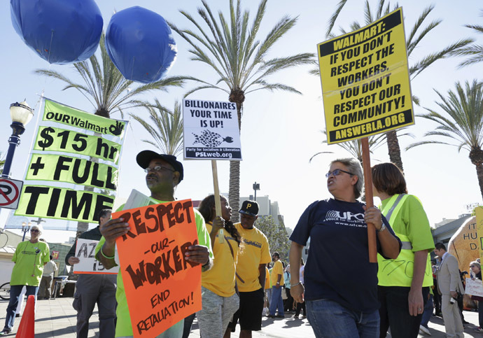People march during a Black Friday protest against Walmart in Long Beach, California November 28, 2014. (Reuters/Jonathan Alcorn)