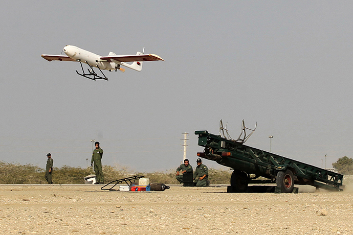 "A picture made available on December 25, 2014 by Iranian Jamejam newspaper's website (Jamejam online) shows Iranian Army ground forces launching an Iranian made drone during the ""Mohammad Rasoul Allah"" military drill in the Oman Sea port city of Bandar Jask in southern Iran (AFP Photo / Chavosh Homavandi)"