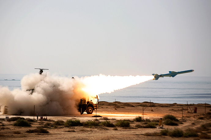 ARCHIVE PHOTO: An Iranian long-range shore-to-sea missile called Qader (Capable) is launched during Velayat-90 war game on Sea of Oman's shore near the Strait of Hormuz in southern Iran (Reuters / Ebrahim Norouzi)