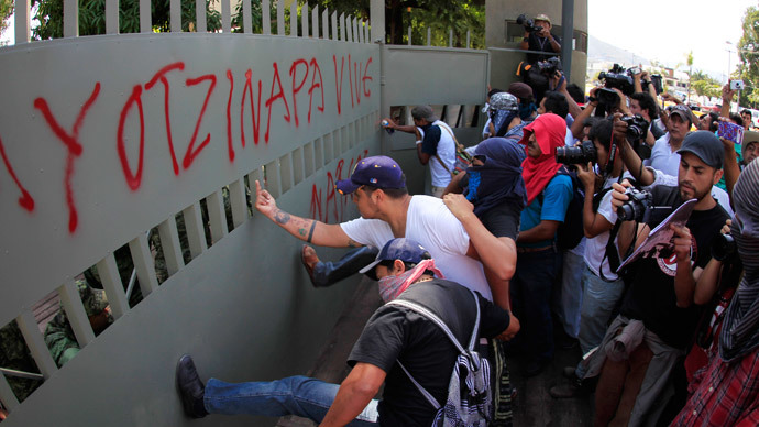 'Here are the murderers': Mexico protesters storm & graffiti military base