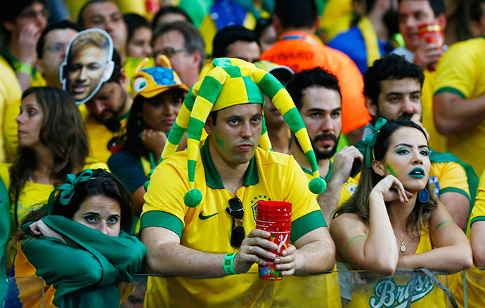 Fans of Brazil react during their 2014 World Cup semi-finals against Germany at the Mineirao stadium in Belo Horizonte July 8, 2014. (Reuters / Eddie Keogh)