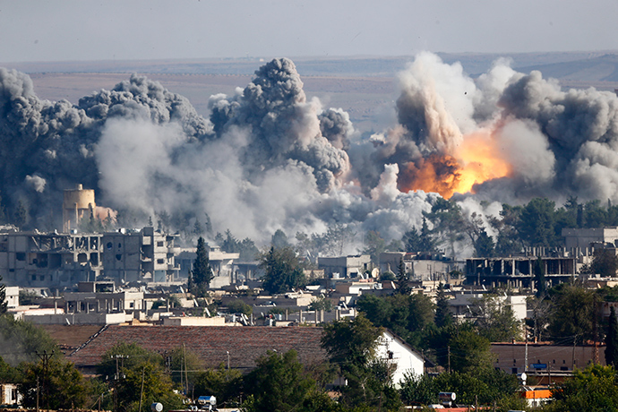 Smoke rises over Syrian town of Kobani after an airstrike, as seen from the Mursitpinar border crossing on the Turkish-Syrian border in the southeastern town of Suruc in Sanliurfa province, October 18, 2014.