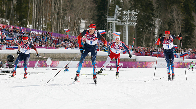 Russia's Alexander Legkov (C) approaches the finish line ahead of his compatriots Maxim Vylegzhanin (L) and Ilia Chernousov (R) and Norway's Martin Johnsrud Sundby during the men's cross-country 50 km mass start free event at the Sochi 2014 Winter Olympic Games in Rosa Khutor February 23, 2014. (Reuters / Stefan Wermuth)