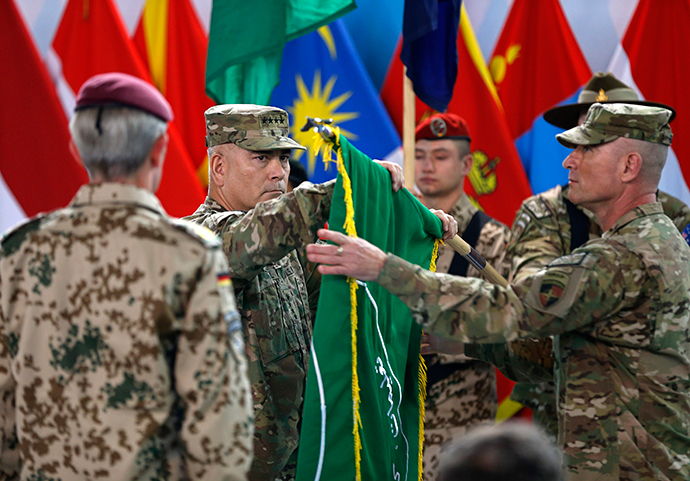 U.S. General John Campbell (C), commander of NATO-led International Security Assistance Force (ISAF), folds the flag of the ISAF during the change of mission ceremony in Kabul, December 28, 2014. (Reuters / Omar Sobhani)